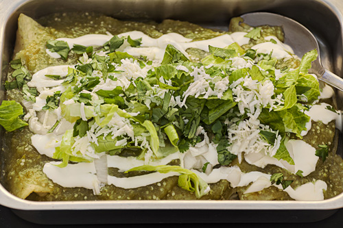 Green Enchiladas with Melted Cheese in the baking dish