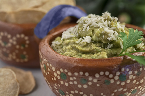 Poblano Pepper Guacamole accompanied with tortilla chips
