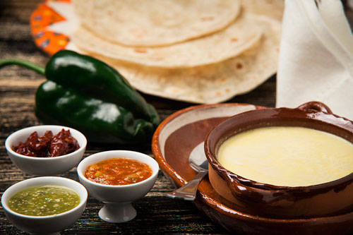 Natural Melted Cheese with flour tortillas and salsas